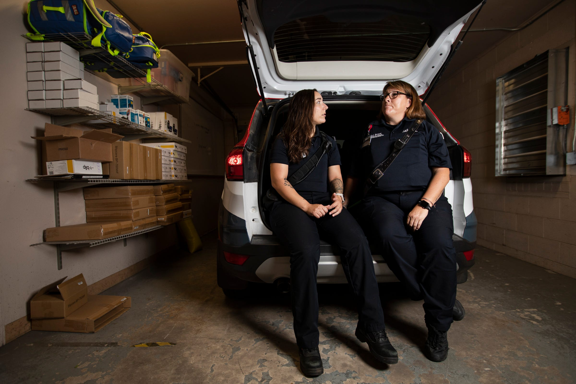 UCHealth community program coordinator and licensed clinician Stephanie Booco, left, and community paramedic Julie Bower talk about the day's calls during a portrait session on Wednesday July 29, 2020, at a UCHealth ambulance station in Fort Collins, Colo.