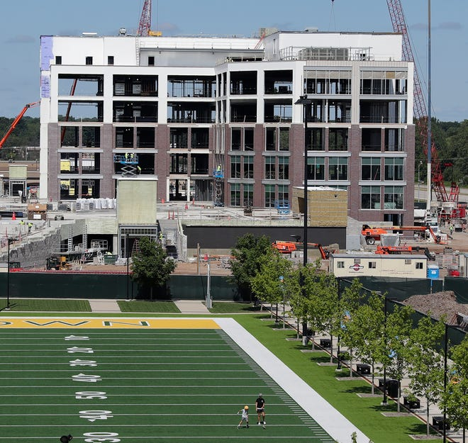 A July 2020 file photo of the office building under construction at the west end of the Green Bay Packers' Titletown District. Breakthrough, a transportation technology company, announced March 29, that it will move its headquarters into the fourth and fifth floors of the building by late fall.