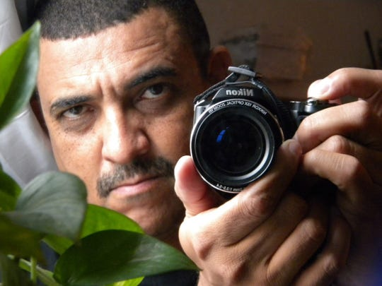 Coralville based filmmaker Steven Berry photographing himself with a Nikon camera.