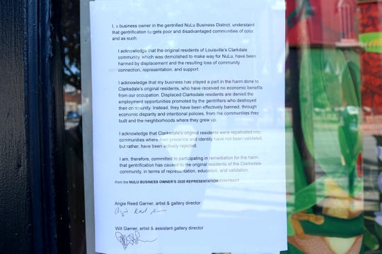 A contract created by Black Lives Matter protesters hangs in the window of Garner Narratives, an art gallery in NuLu.