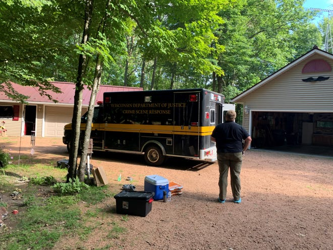 Wood County sheriff's deputies, Marshfield police and state Division of Criminal Investigation agents search a property Thursday, July 30, 2020, in the town of Rock for a man missing since June 13.