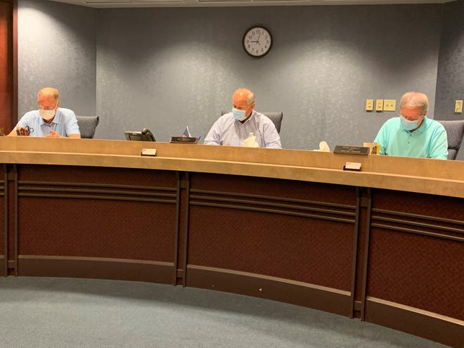 Marion County Commissioners, from left, Andy Appelfeller, Ken Stiverson, and Kerr Murray each donned a face mask during the weekly meeting on Thursday, July 30, 2020. Commissioners unanimously approved placing a 3-mill, 5-year replacement levy to benefit the Marion County Board of Developmental Disabilities on the November general election ballot.