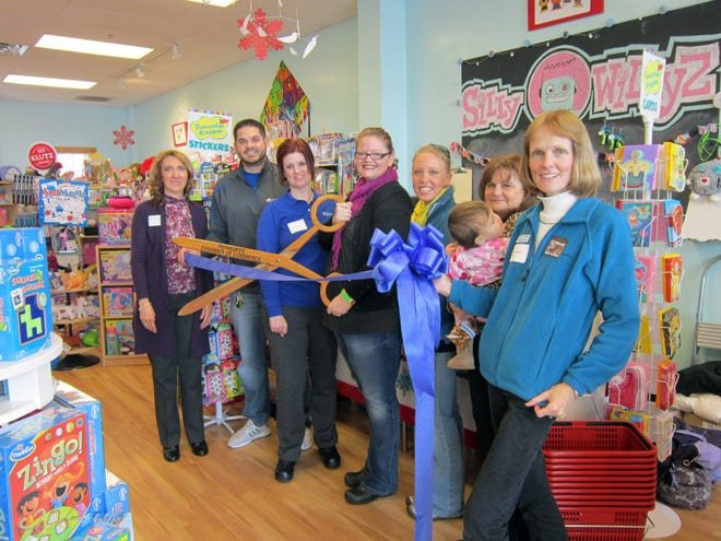 Members of the Pewaukee Chamber of Commerce welcome Silly Willyz toy store in Pewaukee with a ribbon cutting ceremony and plaque presentation in 2014. Silly Willyz has since closed and the Chamber will dissolve soon.