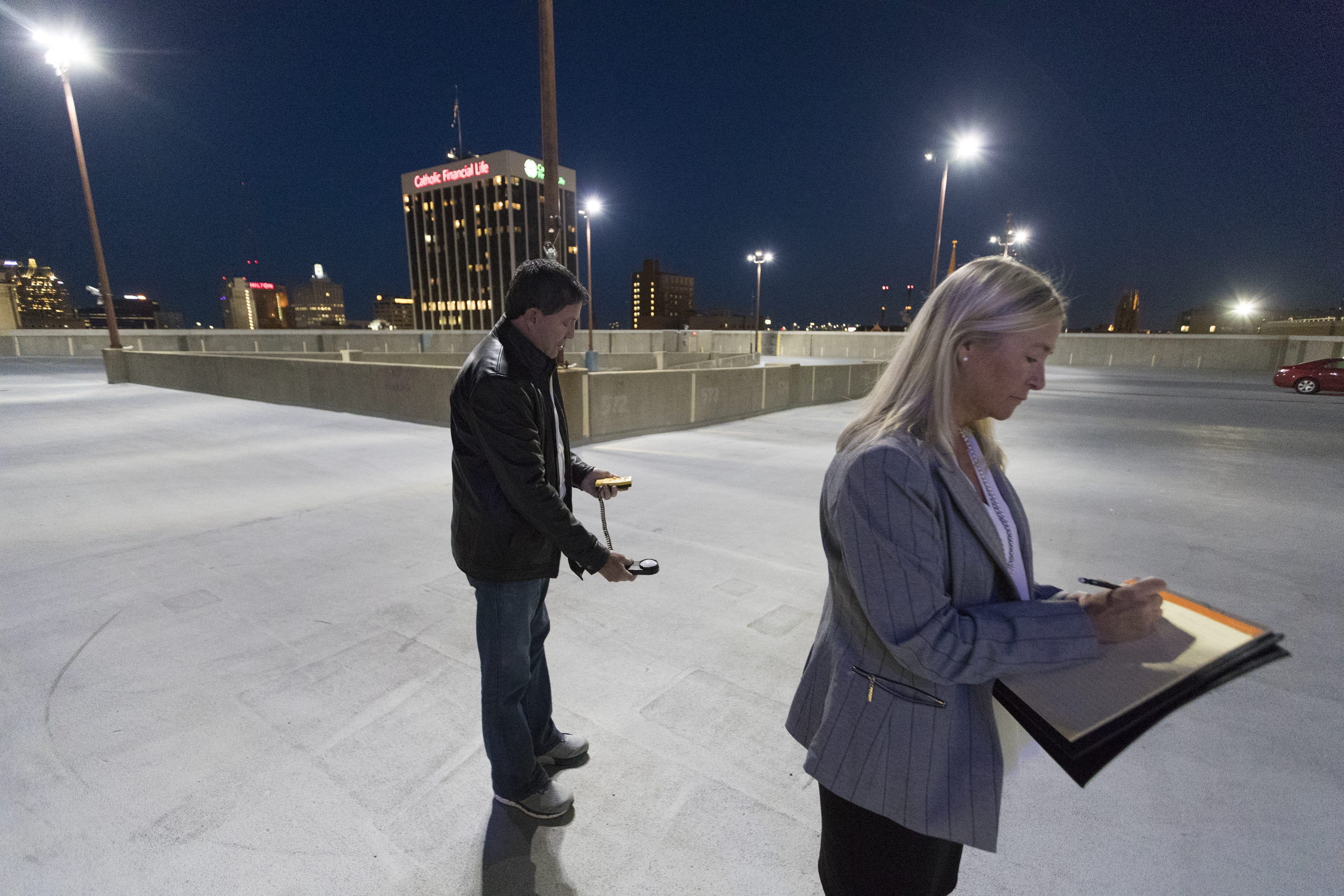 Architectural security consultant Randy Atlas, left, and paralegal-insurance adjuster Jamie Babcock record light level readings May 13, 2019, atop the parking garage at Aurora Sinai Medical Center in Milwaukee. The Journal Sentinel hired Atlas to evaluate security at garages at five Milwaukee hospitals.