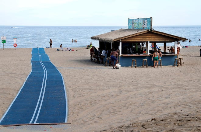 Bradford Beach has a new 100-foot ramp from the street to the beach to help disabled people access the beach. The ramp, made of smooth concrete, is 8 feet wide so people using wheelchairs can easily pass each other. A portable nonslip mat makes up the rest of the distance to the water. The Ability Center, a nonprofit that advocates for accessibility for the disabled, helped advise on the project.