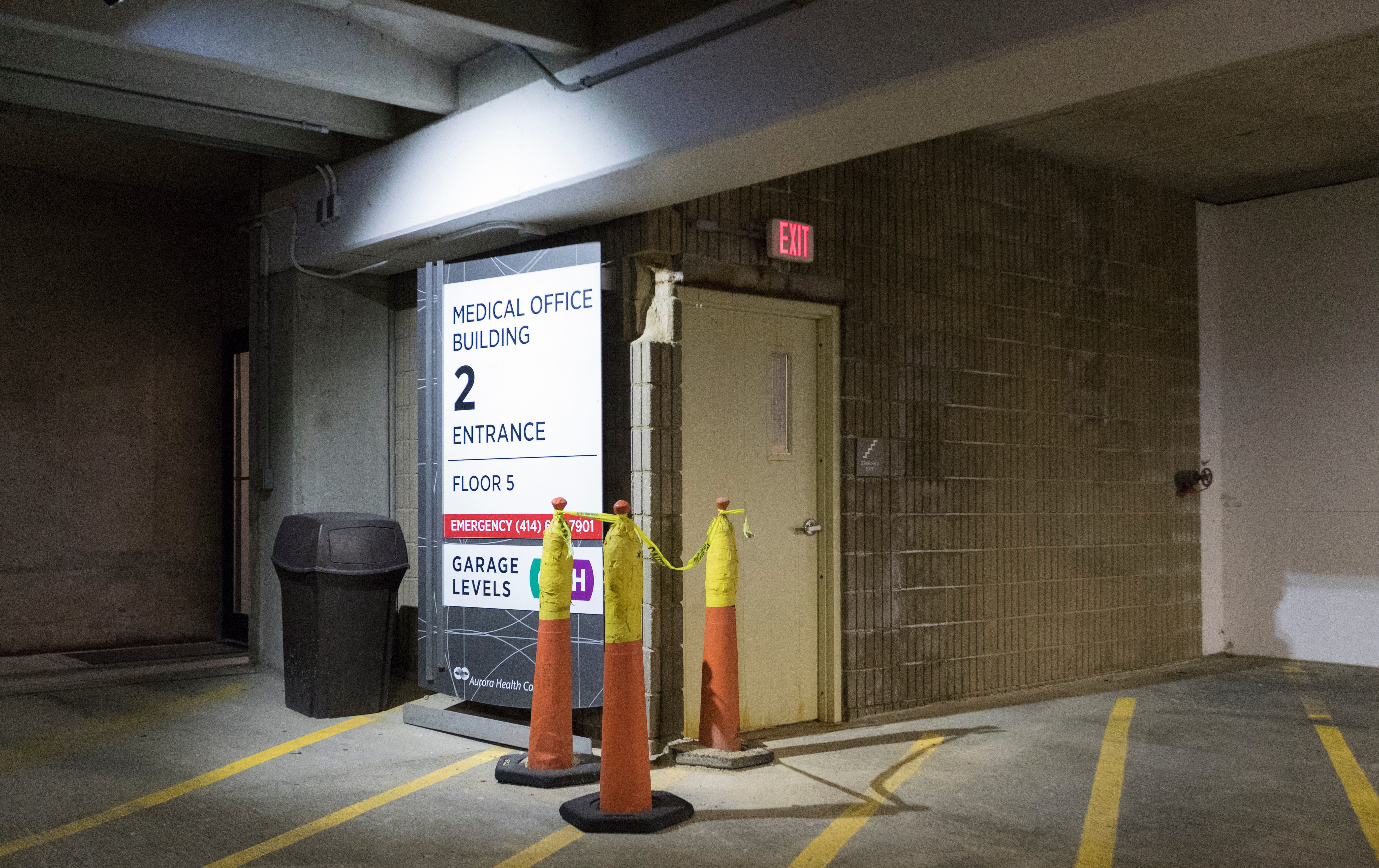 An enclosed stairwell exit with no emergency callbox or video camera is shown Monday, May 13, 2019 in an attached parking ramp at Aurora St Luke's Medical Center in Milwaukee, Wis. The Milwaukee Journal Sentinel enlisted the aid of an architectural security consultant to evaluate parking ramps at five Milwaukee hospitals.MARK HOFFMAN/MILWAUKEE JOURNAL SENTINEL