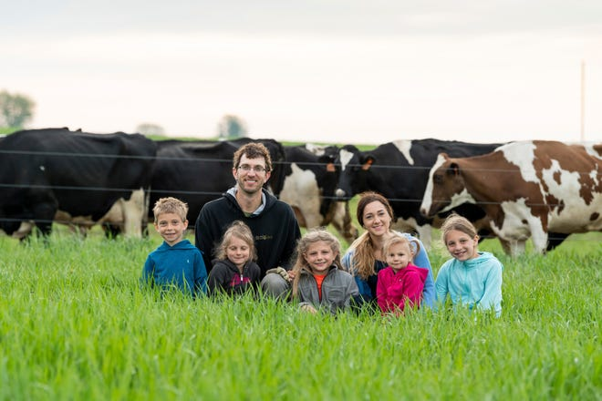 Organic dairy farmers Travis and Stephanie Tranel of Tranel Family Farms with their children  Ossie (from left), Meadow, Violet, Quinn and Evelyn, who represent the seventh generation to farm in the family.