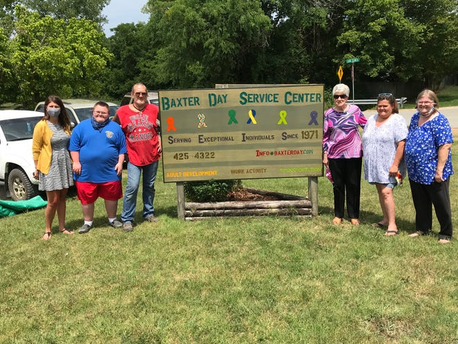 The Twin Lakes Civitan Club recently donated a new sign for the Baxter Day Service Center. The sign was made by club member Roger Hill. Club members pictured above include (from left) Jodi Bodenhamer, Shane Willis, Lou Hill, club president Jenifer Willis and club vice president Lequita Foster.