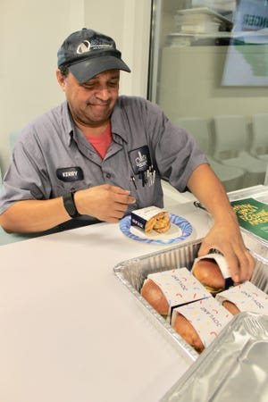 Kerry Lyles, a shopping attendant at Second Harvest Food Bank, grabs a free sandwich delivered from Joyland restaurant in East Nashville.
