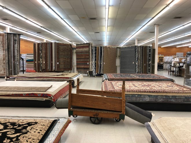 Rugs are displayed at Brentwood Interiors, which is closing its doors after nearly 70 years.