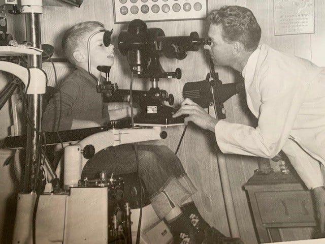 Optometrist Dr. Oscar Marquardt performs an eye exam. This photo was taken circa 1962.