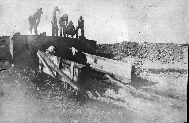Men working on Franklin Schell's canal in the early 1900s. Photo from Ophelia Pitre Lafleur's albums that were saved by Tommy Lafleur years ago.