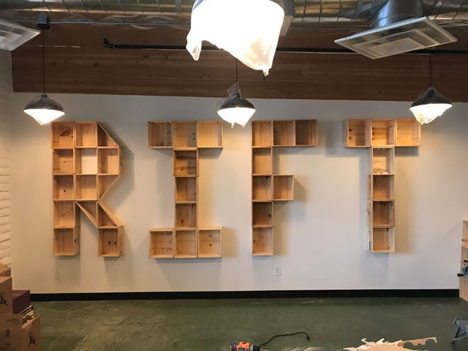 Wine crates spelling Rift decorate one of the interior walls of the new bar and bottle shop expected to open in August.