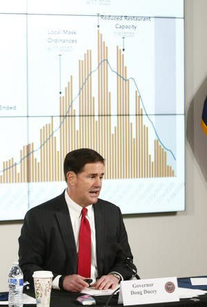 Gov. Doug Ducey talks about the dip in cases during a news conference update on COVID-19 at the Arizona Commerce Authority Conference Center in Phoenix on July 30, 2020.