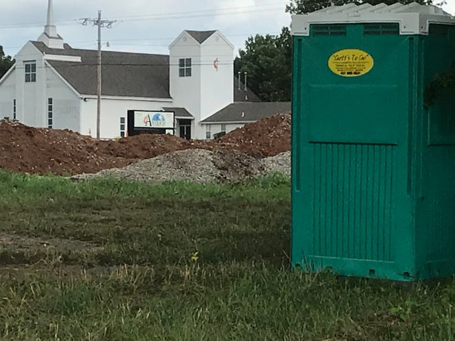 Answer Man: What's being built at northwest corner of Glenstone Avenue (State Highway H) and East Valley Water Mill Road?  The Antioch United Methodist Church is in the background.