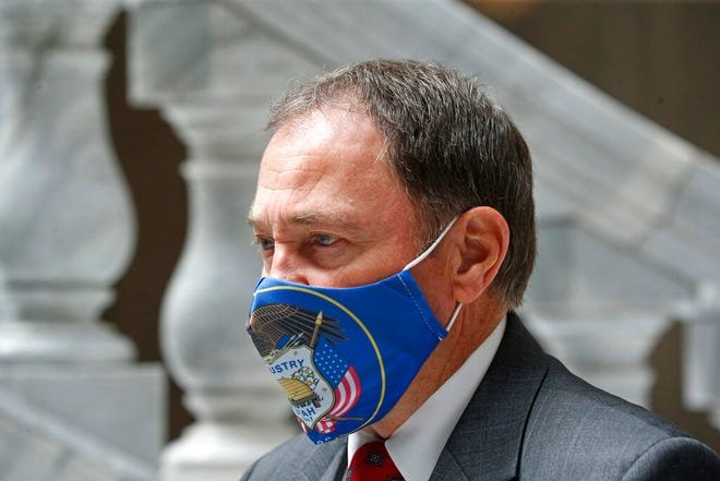 "Utah Gov. Gary Herbert walks through the rotunda to a COVID-19 briefing Thursday, July 30, 2020, in Salt Lake City. Herbert said the state has no intention of delaying the November election following President Donald Trump's suggestion on Thursday that increased mail-in voting due to the coronavirus pandemic would result in fraud. Herbert said there's been no evidence of tampering with mail-in ballots and characterized postponing the election in Utah as ""foolish."" (AP Photo/Rick Bowmer)"