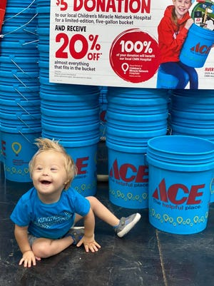 Axel Brock, a Children's Miracle Network miracle, reminds shoppers at Ace Hardware of the annual Miracle Bucket Days Friday through Sunday, when most everything you can fit inside is 20 percent off and all proceeds benefit Children's Miracle Network.