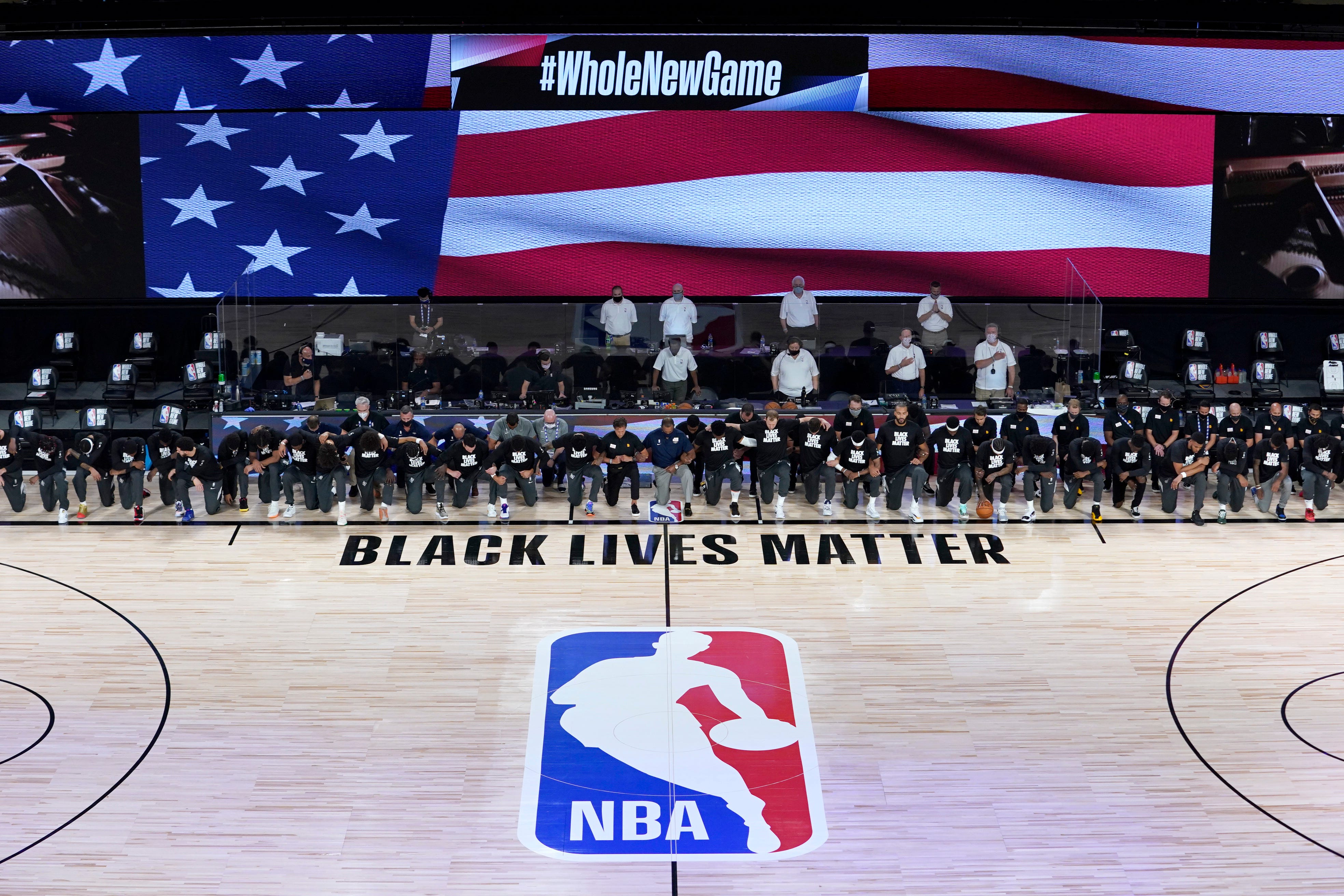 Pelicans, Jazz and Lakers, Clippers lock arms and kneel during national anthem before NBA restart openers