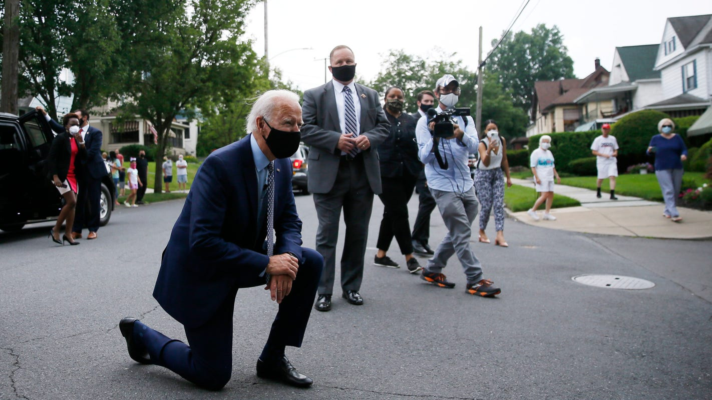 Fact check: Joe Biden didn't take a knee upon seeing a flag; he was talking to a child