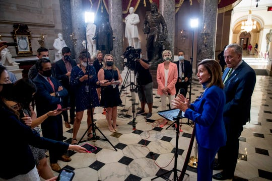 House Speaker Nancy Pelosi, D-Calif., and Senate Minority Leader Chuck Schumer of N.Y., speak to reporters after a meeting with Treasury Secretary Steven Mnuchin and President Donald Trump's Chief of Staff Mark Meadows on Capitol Hill in Washington on Wednesday.