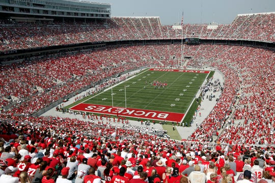Ohio State will limit home crowds to about 20,000 and prohibit tailgating if the football season is played this fall. Fans inside Ohio Stadium will be required to wear masks and observe social distancing to help stem the spread of the coronavirus pandemic.