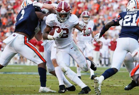 Alabama running back Najee Harris runs the ball past the  Auburn defense during the second quarter of their 2019 game at Jordan-Hare Stadium.