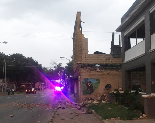 First responders secured the scene of a downtown building that partially collapsed Thursday evening near Second Avenue NE and North Washington Avenue as thunderstorms moved through the area.