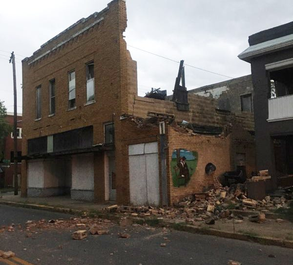First responders secured the scene of a downtown building that partially collapsed Thursday evening near Second Avenue NE an North Washington Avenue as thunderstorms moved through the area.