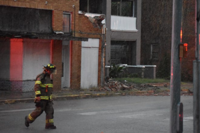 Ardmore firefighters respond to a collapsed building on the corner of North Washington Street and 2nd Avenue Northeast Thurday night.