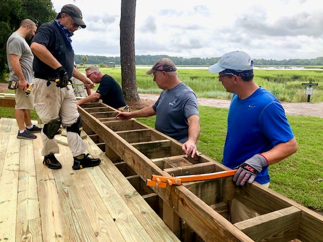 The Oldfield Volunteer Corps, consisting of more than 75 volunteers, works together to complete various work projects in the community.