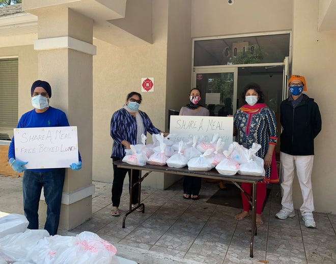 Members of the Northeast Florida Sikh community provide meals, bottled water and masks to area homeless people during the pandemic. [Provided by Gurudwara Jacksonville]