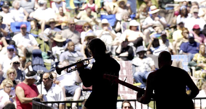 Chris Bottin (left) performs at the 2003 Jacksonville Jazz Festival at Metropolitan Park. [Bob Mack, Florida Times-Union]