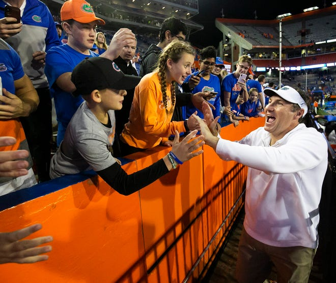 University of Florida football coach Dan Mullen is congratulated by fans after the Gators' 40-17 victory over Florida State last year in Gainesville.