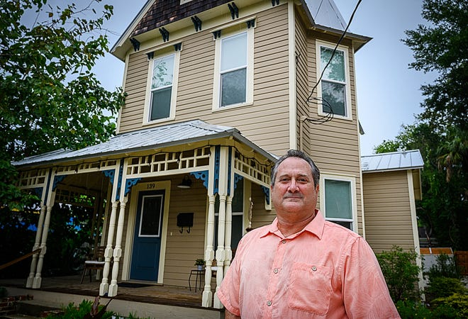 Michael Southerland stands in front of a home on Wednesday on Oneida Street in St Augustine that he rents short term to tourists. [Peter Willott/St. Augustine Record]