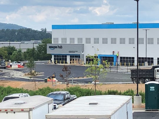 Work is nearing completion on the Amazon hub in Mills River. The 112,000-square-foot warehouse will employ about 200 people when it opens later this year.