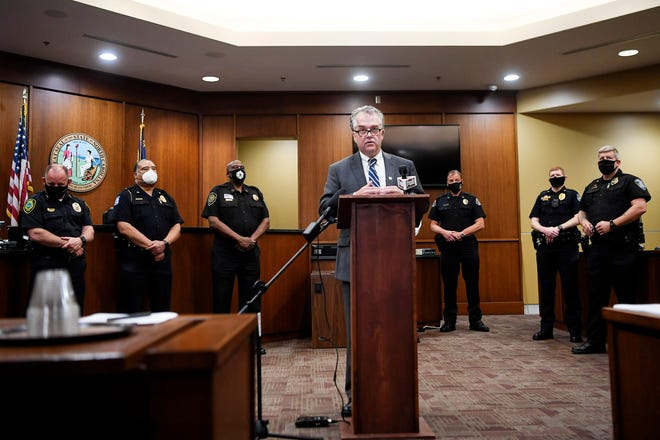 Buncombe County District Attorney Todd Williams speaks before leaders of Buncombe County's law enforcement agencies signed an officer misconduct agreement July 30, 2020 in Asheville.