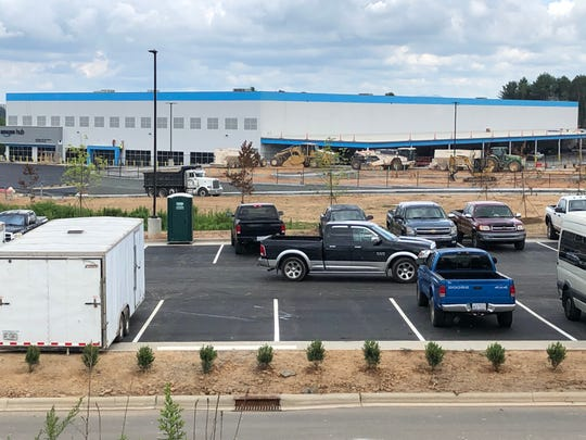 Dozens of construction workers were on site at the Amazon distribution hub on July 30, 2020. The $28 million operation will employ about 200 people when it opens later this year.
