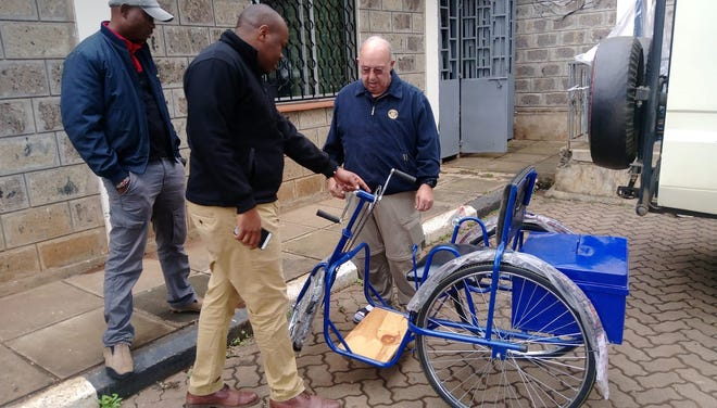 Bob Cairns, a member of Port Orchard Rotary, volunteered in Africa in efforts to eradicate polio among other humanitarian projects. He is pictured here with a custom bicycle he had built for a man whose mobility was impaired by the disease.