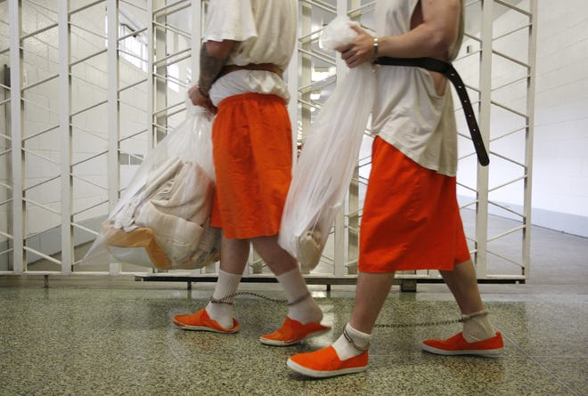 Inmates make their way down a hallway before being transported from the Lebanon Correctional Institute in a photo from 2009.