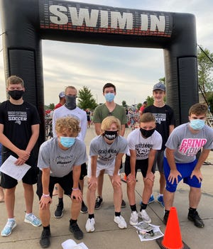The Ankeny Centennial boys soccer team may have had their spring season cancelled, but they are finding ways to still work together as a team while helping their community. Pictured are players volunteering at the City of Ankeny's Youth Triathlon on Saturday, July 25, 2020.