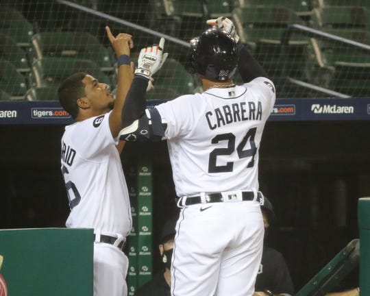 Third Tiger bassist Jeimer Candelario celebrates with DH Miguel Cabrero after his performance against pitcher Royals Ian Kennedy during the eighth improvement of the 5-3 tiger loss in Comerica Park on Thursday, July 30, 2020.