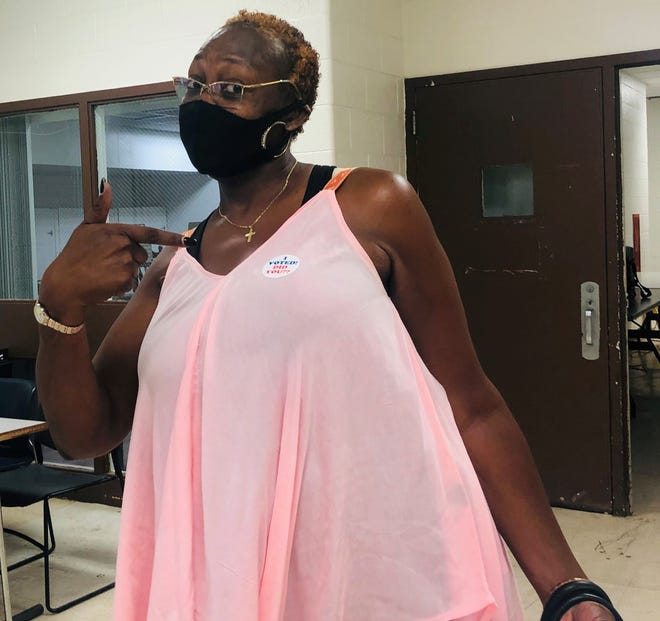 LaWanda Hollister, of Detroit, poses for a photo after voting for the first time Thursday, July 30, 2020.