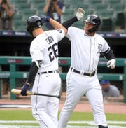 Tigers first baseman C.J. Cron, right, celebrates with DH Miguel Cabrera after Cabrera's homer against Royals pitcher Brady Singer during the first inning at Comerica Park on Thursday, July 30, 2020.