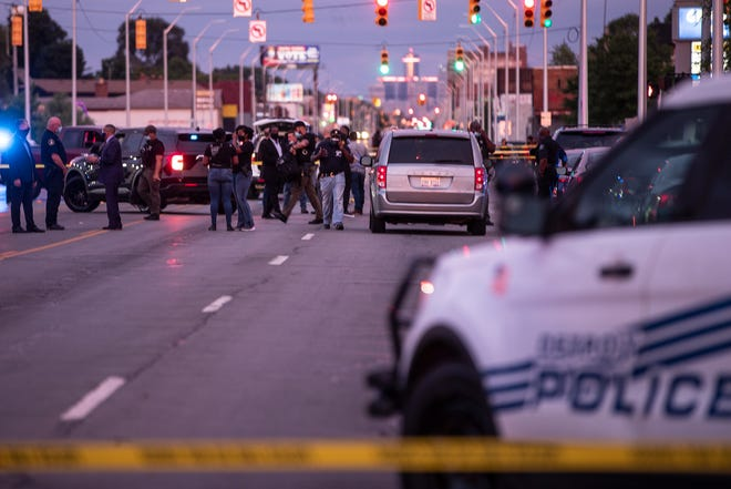 Detroit Police Department investigate an officer involved shooting near Grand River Avenue and Meyers Road in Detroit, Thursday, July 30, 2020.