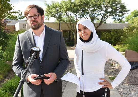 Attorneys representing Grace, John Biernat and Siam Khalil talk to reporters about the release of Grace this afternoon from detention at Children's Village on Friday,  July 31, 2020, in Pontiac.