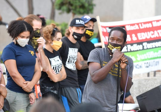 Tristan Taylor speaks to the crowd at the Detroit Will Breathe rally at the McNamara Federal building in Detroit on Friday.