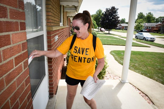 """Trenton resident Amy Chappelle delivers fliers door-to-door in Trenton announcing a peaceful protest against the former McLouth Steel Trenton Plant, Friday, July 31, 2020. """"I want the residents and homeowners to know what's going on. My message is """"no industrial waterfront."""""""