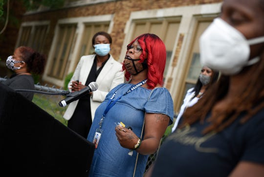 Ta'Mara Williams speaks during a Detroit Public Schools Community District Reopening of schools parent press conference at the Golightly Education Center in Detroit Friday.