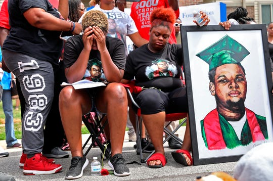 Trinetta Brown, center left, 19, and Triniya Brown become emotional during a memorial service for their brother, Michael Brown, Thursday, Aug. 9, 2018, in the Canfield Green apartment complex in Ferguson, M