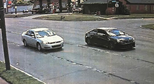 A surveillance camera captured the cars police said were involved in a road rage incident before the shooting.